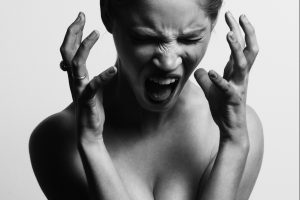 Woman screaming in fear of public speaking?